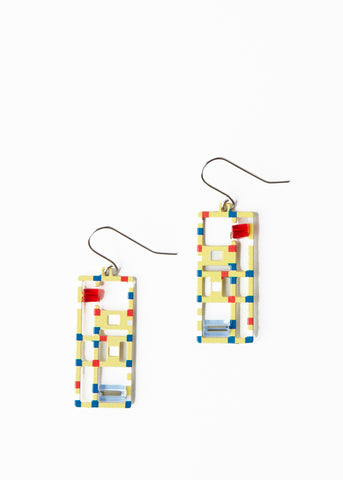A pair of yellow rectangular earrings with red and blue accents.