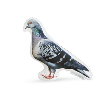 A pigeon shaped pillow with left facing image of a beautiful pigeon in soft, muted colors. The right facing pigeon image is different from the left facing pigeon pillow image.
