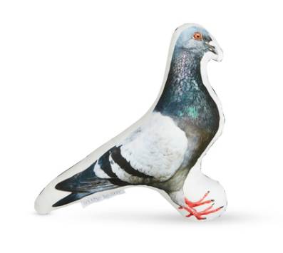A pigeon shaped pillow with right facing image of a beautiful pigeon in soft, muted colors.