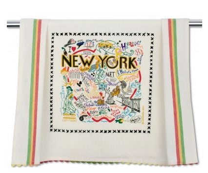 "A white dish towel with a red, yellow and green stripe down each side, and hand dyed red, yellow and green rickrack at the top and bottom, printed with ""NEW YORK"" in black lettering surrounded by neighborhoods or locations spelled out with accompanying images. Includes places such as SoHo, Madison Square Garden, Times Square and the Guggenheim, among others, all embroidered in a variety of bright colors."