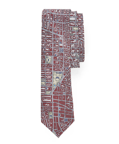 A men's tie with NYC city grid with deep burgundy buildings and silver streets.