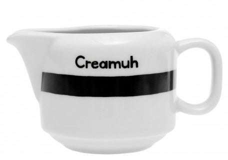 "A white ceramic creamer with the saying ""Creamuh"" printed in black with a black band around the middle."