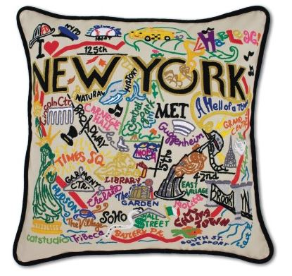 A square pillow with NEW YORK in black lettering surrounded by neighborhoods or locations spelled out with accompanying images. Includes places such as SoHo, Madison Square Garden, Times Square and the Guggenheim, among others, all embroidered in a variety of bright colors. This coordinates with the New York City dish towel.