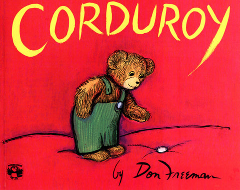A red corduroy board book with a stuffed bear illustration on the cover.