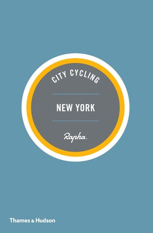 "A light blue pamphlet with three concentric circles at the center in white, orange, and gray with text ""City Cycling New York""."