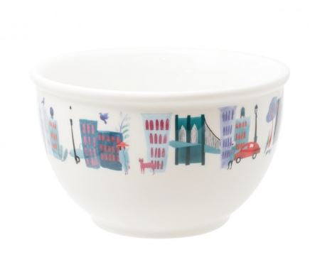 A white ceramic bowl with colorful graphic depictions of iconic New York City landmarks. Coordinates with Collage City Mug by Beatriz Gutierrez.