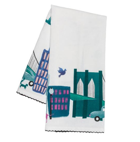 A white towel with a turquoise depiction of New York City.