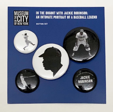 A set of five black and white Jackie Robinson pins with a blue paper backing.