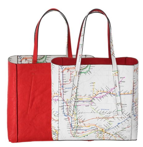A white reversible tote bag featuring the NYC Subway map print with the dimensions of twelve and a half inches in height, fourteen inches in width and six inches in depth. The inside of the bag is red.