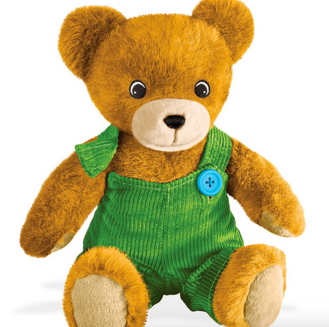 A corduroy the bear plush stuffed animal with green corduroy overalls that have a missing button.