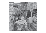 postcard of Stanley Kubrick photo of woman and child shopping