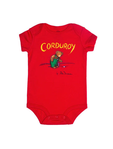 "Red baby onesie with ""Corduroy"" written at the top, above an image of Corduroy looking down at his missing button"