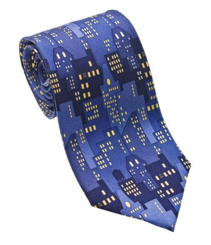 A blue silk tie with an allover print of buildings at night with the lights on.