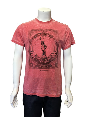 A soft red t-shirt with black illustration and emblem of the State of Liberty in a postage stamp.