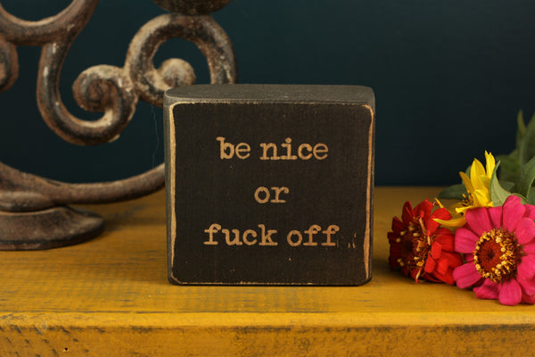 "Adult office decor with the words ""Be nice or fuck off"""