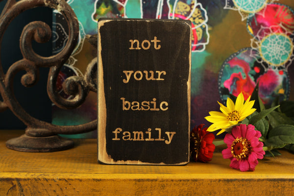 "Family sign wooden decor block with the quote ""not your basic family"""