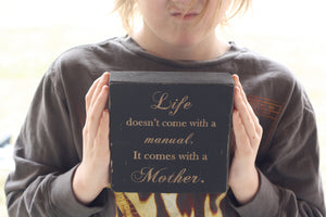 Small wooden sign - Life doesn't come with a manual