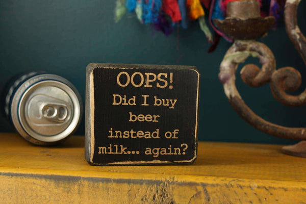 "Beer decor block with the words ""Oops! Did I buy beer instead of milk...again?"""