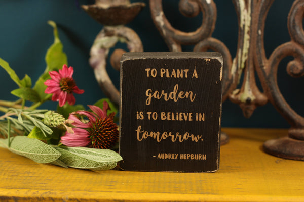 "Gardener gift salvaged wood sign with the quote ""To plant a garden is to believe in tomorrow."""