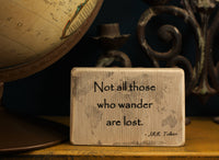 "Travel gift wooden decor block with the quote ""Not all those who wander are lost"""