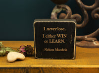 "Inspirational office quote block with the quote ""I never lose. I either WIN or LEARN"" - Nelson Mandela"""