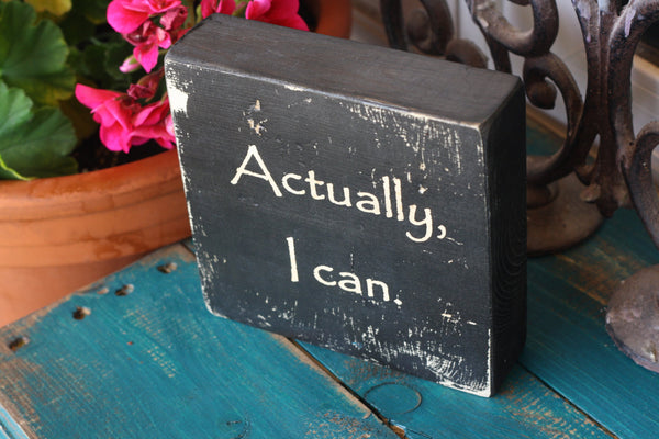 "Office decor wooden quote block with the saying  ""Actually, I can."""