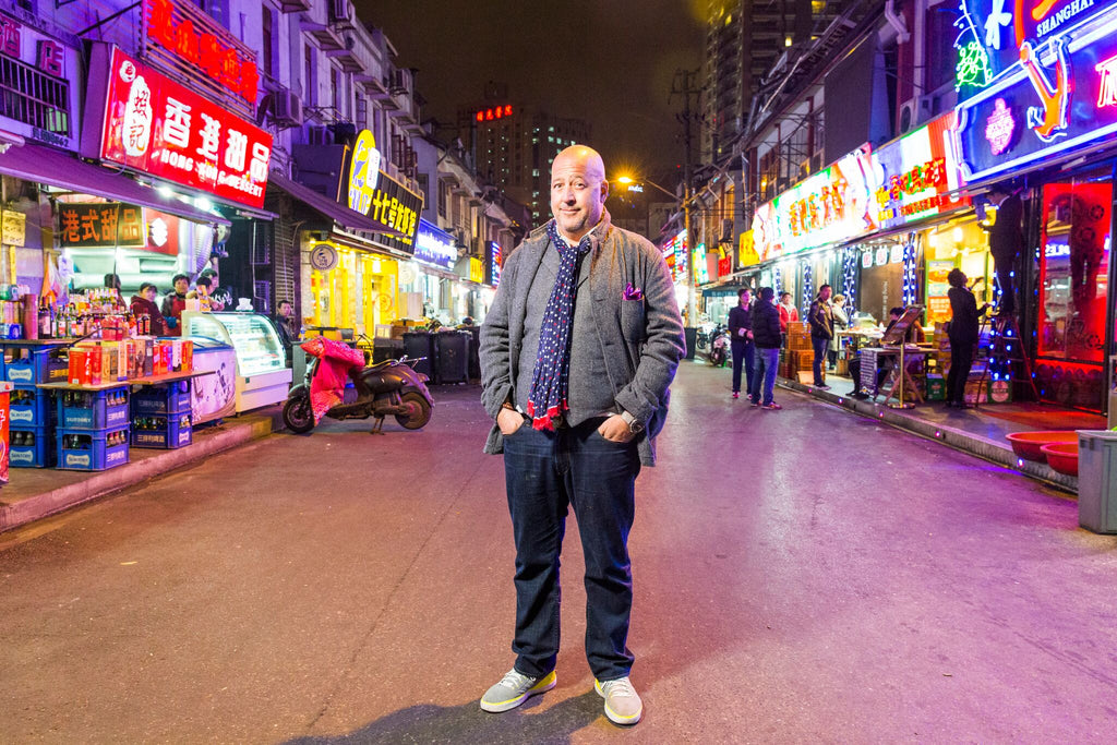 Andrew Zimmern, standing in the street at night