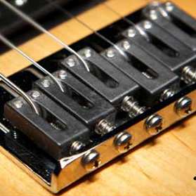 Bustin' a Dinger: How Graph Tech String Saver Saddles Alleviate String Breakage