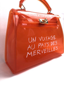 Crystal orange voyage bag