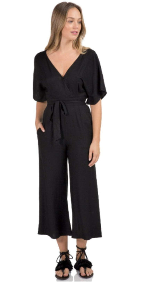 be8902491c6 Elan Romper Ruffle Top Jumpsuit in Black SC7142-BLK front view studio model