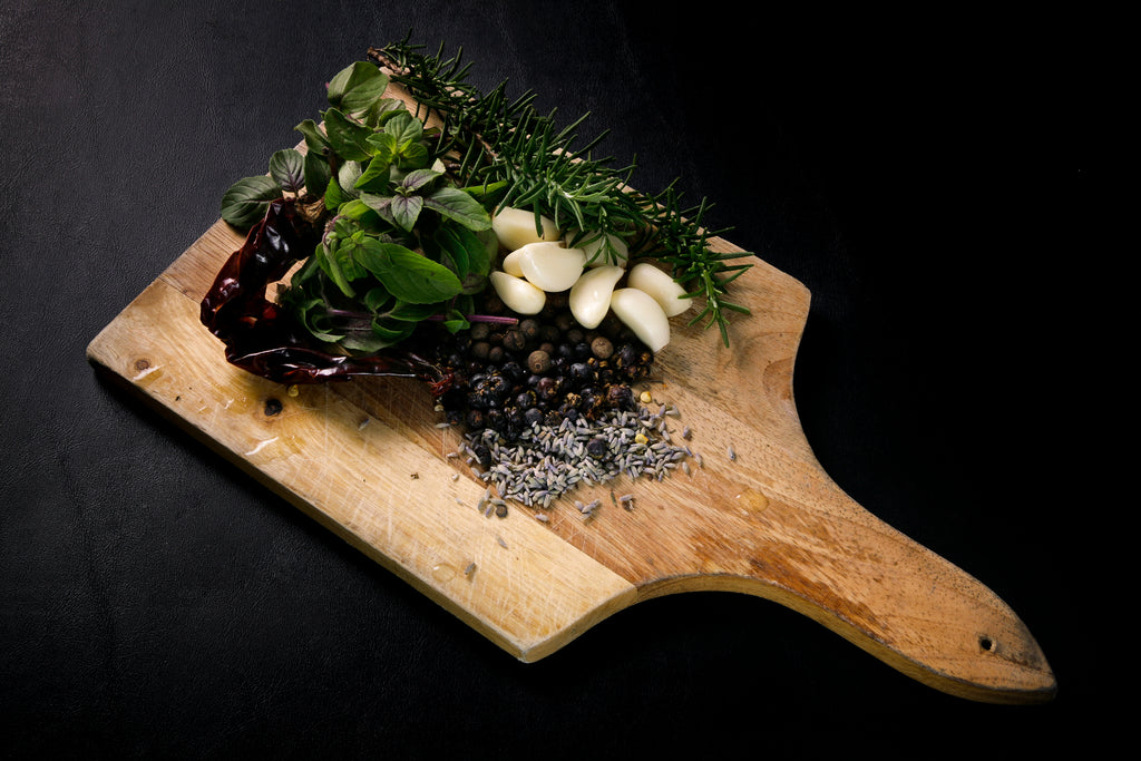 Spices and herbs on cutting board