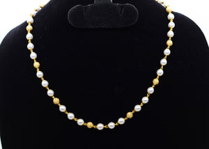 Gold plated necklace with off white beads and golden balls. -  by Shrayathi