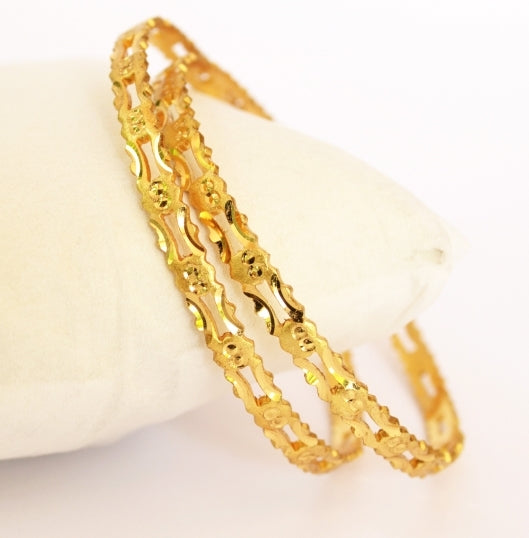 Elegant machine cut bangle - Bangle by Shrayathi