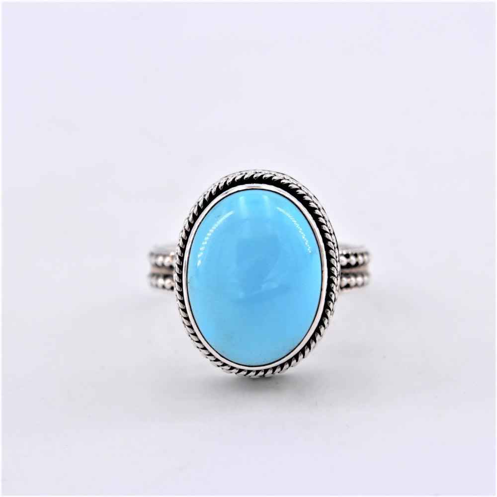 Oval Turquoise Ring with Beading Design