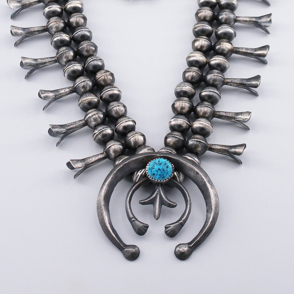 Gerald Mitchell: Sandcast Naja and Sterling Silver Squash Blossom Necklace and Earrings Set