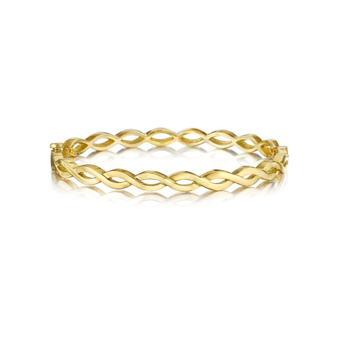 TWISTED YELLOW GOLD BANGLE