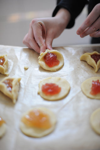 Pinching the first corner of the Hamantaschen
