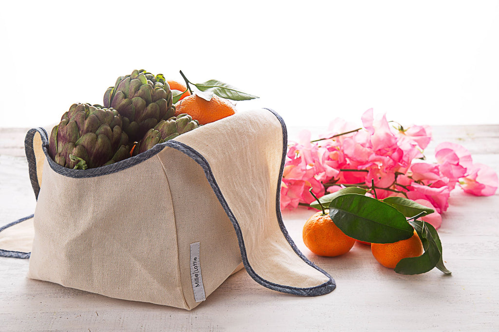 canvas produce bag with blue trim hold fruit and vegetables
