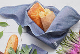 reusable lunch bag in chambray by Millie Lottie holds a sandwich and chips