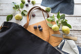 Millie Lottie Etta Food & Picnic Tote, Large, Black Canvas on Table with removable cutting board surrounded by pears