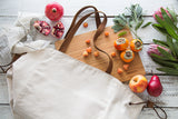 Millie Lottie Etta Food & Picnic Tote, Large, Natural Canvas on table surrounded by fruit