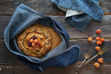 Heirloom Wrap in Medium by Millie Lottie carries a fruit galette on the cutting board. (sold separately)