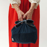 cloth denim wrap by Millie Lottie  holds a side dish bowl. (reusable bags)