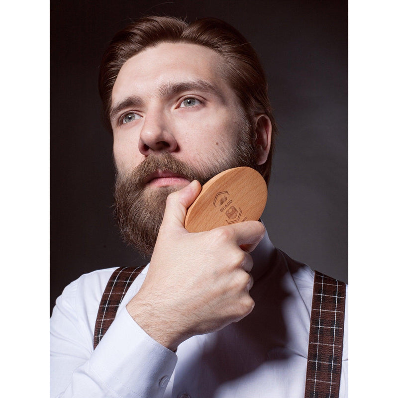 Bearded man brushing his beard with a Beard Reverence boar bristle brush