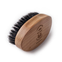 Beard Reverence 100% Boar bristle. Features a handle made of wood with a company logo.