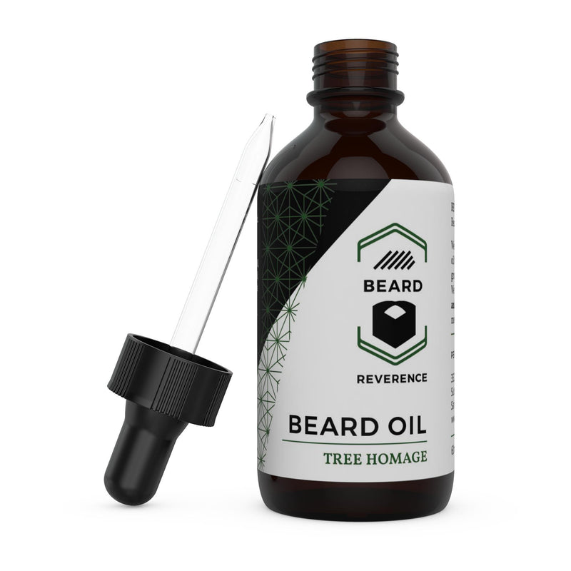 Beard Reverence Tree Homage Beard Oil with dropper top laying next to it.