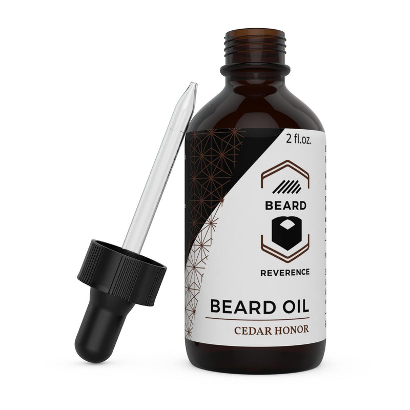 Beard Reverence Cedar Honor Beard Oil with dropper top laying next to it.