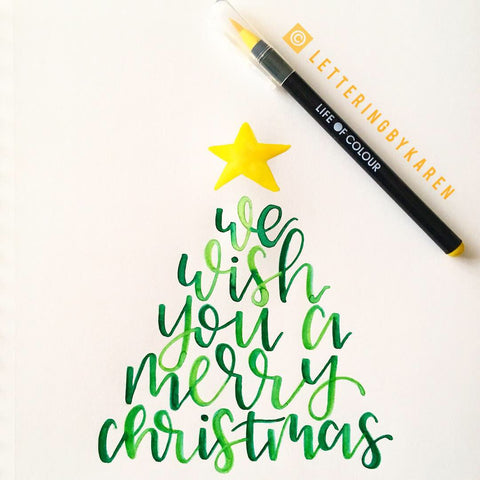we wish you a merry christmas brush lettering in christmas tree with life of colour pens