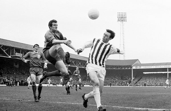 "Tommy Lawrence, the Liverpool goalkeeper, ""gallops"" through the air to beat West Bromwich Albion centre-forward Jeff Astle to the ball in the sixth round FA Cup tie at West Bromwich in 1968."
