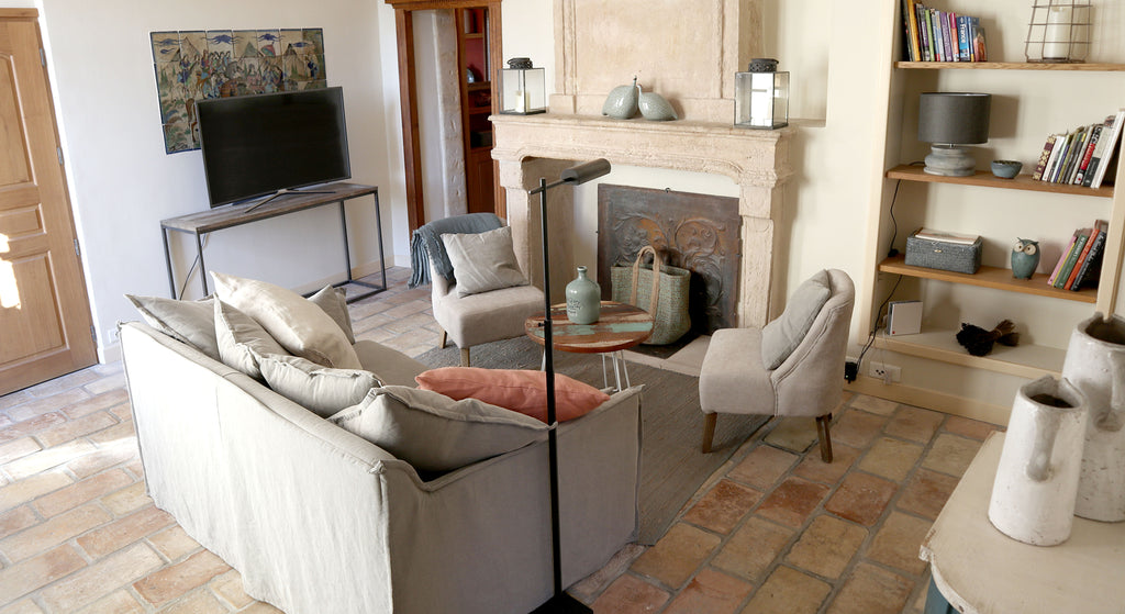The Living Room Features A Decorative Stone Fireplace Stately High Ceilings With Traditional Exposed Beams Original Terracotta Floor Tiles An Arched